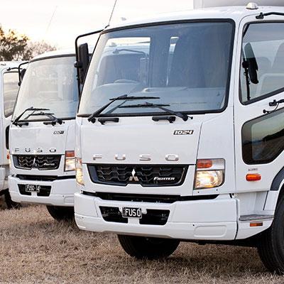 Two Fuso trucks side by side