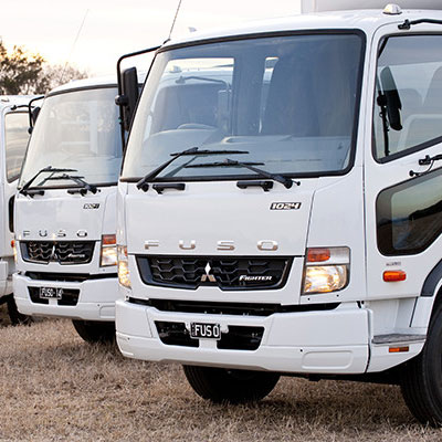 Two Fuso trucks side by side
