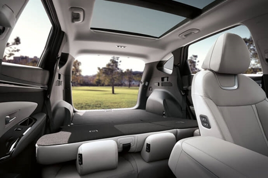 Hands-free rear seat folding system.