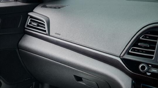 Carbon fibre effect trim.