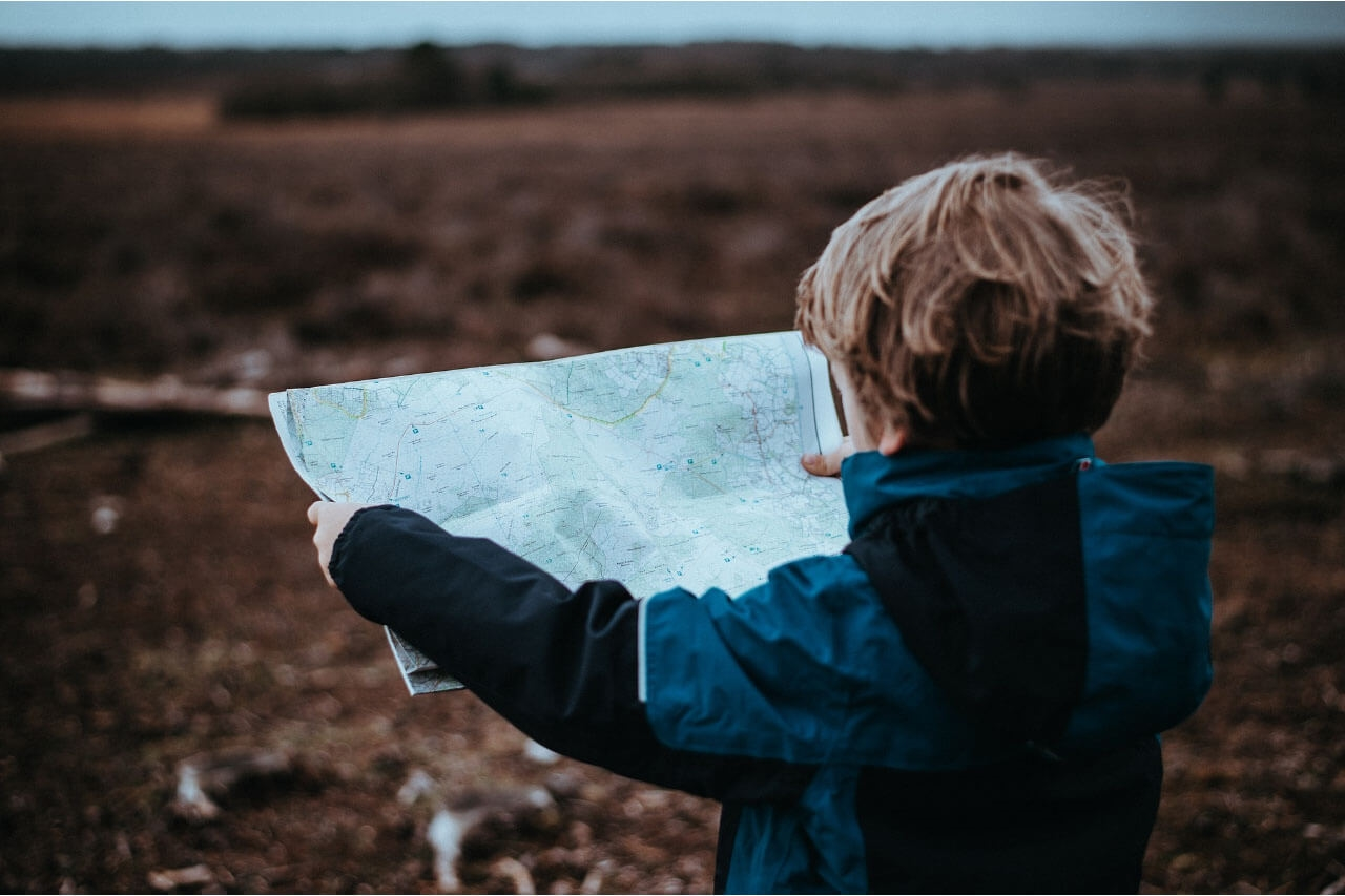 child reading a road map
