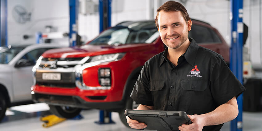 Mt Gravatt Mitsubishi Mechanic Servicing a Vehicle