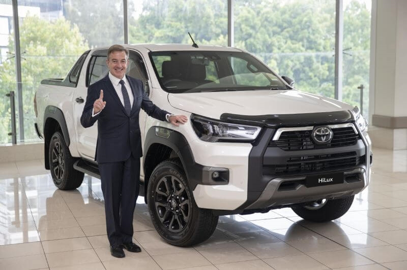 Toyota Australia President & CEO Matthew Callachor with Australia's top selling vehicle for 2020 Toyota HiLux. (Vehicle shown with optional extras)