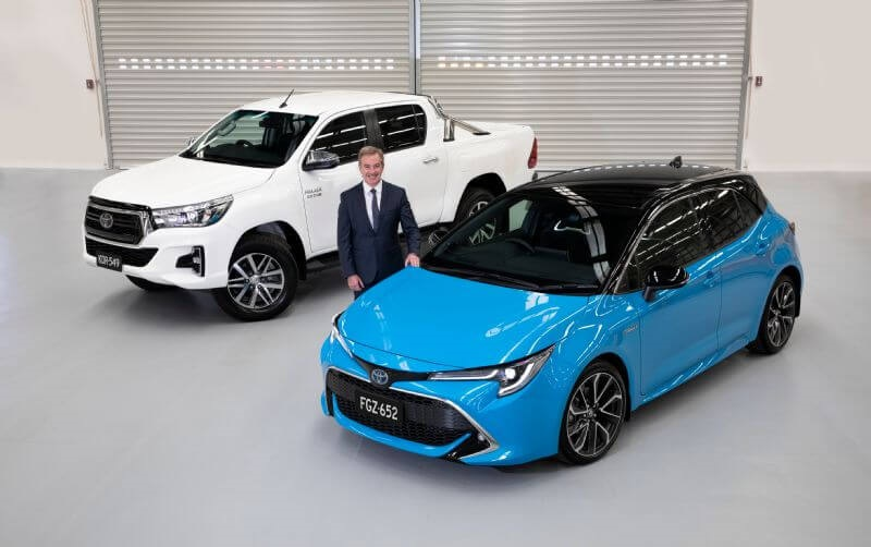 Toyota Australia President Matthew Callachor with Australia's best-selling vehicle HiLux and best-selling passenger car Corolla.