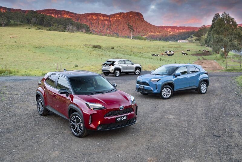 Toyota Yaris Cross Urban hybrid AWD with optional black roof (front), Toyota Yaris Cross GXL hybrid (middle), Toyota Yaris Cross GX petrol (rear)