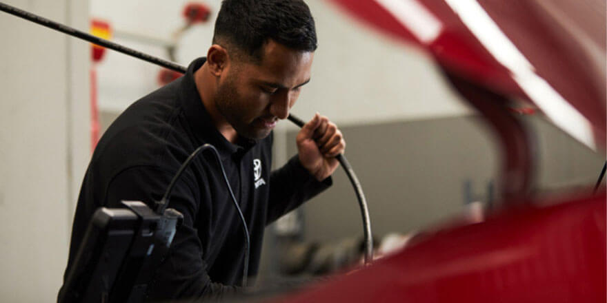Toyota Mechanic Servicing a Vehicle from Dwyers Toyota