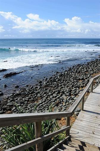 Wooden boardwalk overlooking the ocean