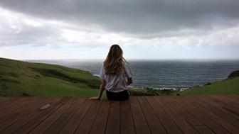 Girl looking into the ocean